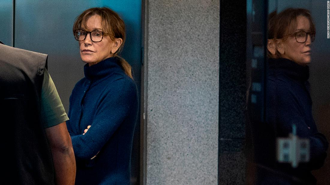 "Actress Felicity Huffman is seen inside a federal building in Los Angeles after she appeared in court on Tuesday, March 12. Huffman is one of 50 people who have been charged in <a href=""https://www.cnn.com/2019/03/12/us/college-admission-cheating-scheme/index.html"" target=""_blank"">what is being called the largest college admissions scam ever prosecuted.</a> Wealthy parents, coaches and college prep executives have been accused of carrying out a nationwide fraud to get students into prestigious universities, according to a federal indictment. Huffman is accused of paying $15,000 to a fake charity to facilitate cheating for her daughter on the SATs."