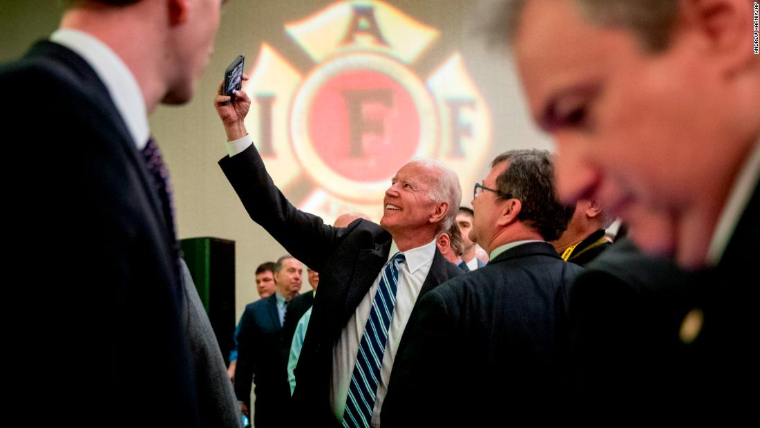 "Former Vice President Joe Biden takes a photo on Tuesday, March 12, after speaking to the International Association of Firefighters. Biden <a href=""https://www.cnn.com/2019/03/13/politics/chris-coons-joe-biden-for-president-cnntv/index.html"" target=""_blank"">teased a possible presidential run</a> while speaking to applauding supporters in Washington: ""I appreciate the energy you showed when I got up here. Save it a little longer, I may need it in a few weeks."""