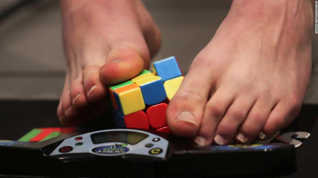 Daniel Rose-Levine, who holds the Guinness World Record for solving a Rubik's Cube with his feet (16.96 seconds), practices in New York on Monday, March 11.