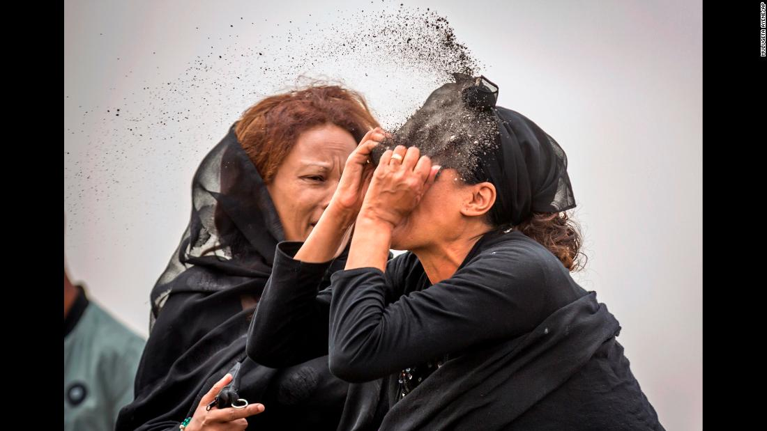 "A relative of a victim from <a href=""https://www.cnn.com/2019/03/11/world/gallery/ethiopia-plane-crash-intl/index.html"" target=""_blank"">Ethiopian Airlines Flight ET302</a> throws dirt in her face as she mourns at the crash site near Bishoftu, Ethiopia, on Thursday, March 14. The plane crashed shortly after takeoff on Sunday, killing all 157 on board."
