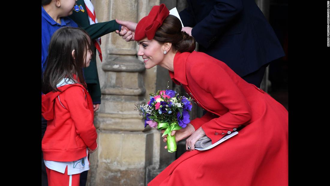 Catherine, the Duchess of Cambridge, speaks with a young girl in London while attending Commonwealth Day services at Westminster Abbey on Monday, March 11.