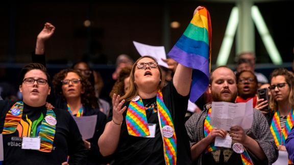 Protesters share their view during the United Methodist Church's special session of the General Conference in St. Louis in February.