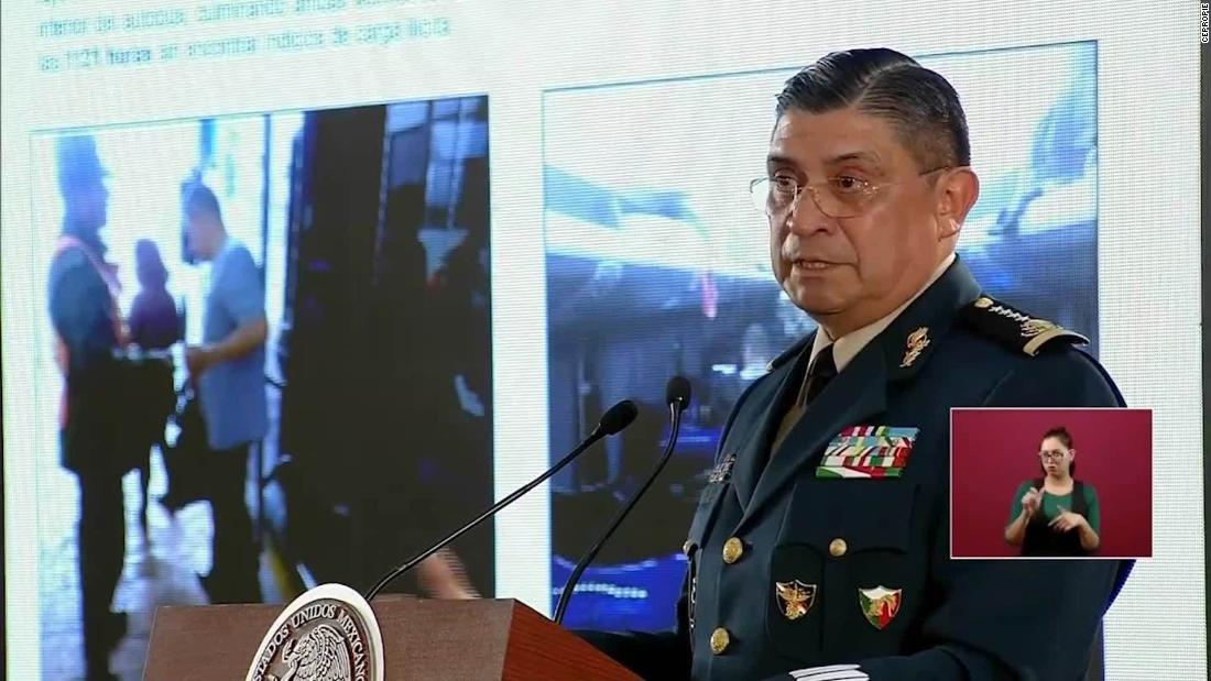 In a press conference broadcast Thursday morning, Mexican Defense Secretary Luis Crescencio Sandoval González shows reporters photos of the bus taken at a military checkpoint more than an hour before gunmen intercepted it.