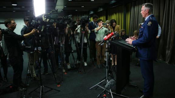 Police Commissioner Mike Bush speaks to the media during a news conference in Wellington. Bush said two improvised explosive devices were attached to a vehicle as part of the attack. One device was disabled and authorities were working on the other.