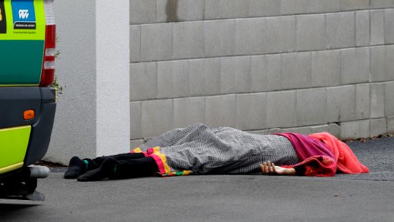 A body lies outside one of the mosques.