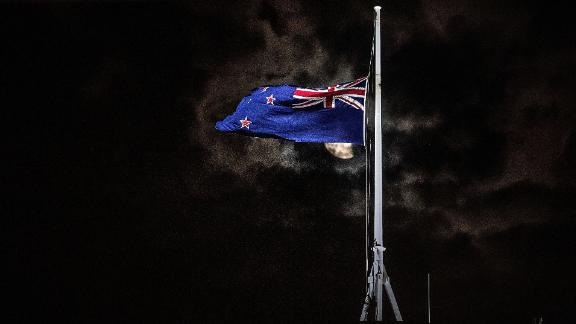 TOPSHOT - The New Zealand national flag is flown at half-mast on a Parliament building in Wellington on March 15, 2019, after a shooting incident in Christchurch. - Attacks on two Christchurch mosques left at least 49 dead on March 15, with one gunman -- identified as an Australian extremist -- apparently livestreaming the assault that triggered the lockdown of the New Zealand city. (Photo by Marty MELVILLE / AFP)        (Photo credit should read MARTY MELVILLE/AFP/Getty Images)