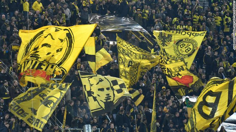 Dortmund fans wave flags ahead of a Champions League game.