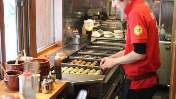A chef in Tokyo's Akasaka district prepares takoyaki -- deep-fried octopus balls.