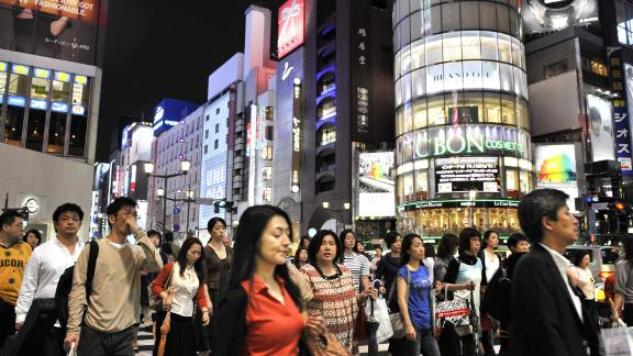 Pedestrians cross an intersection in Tokyo's Ginza district