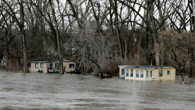 Flooding from melting snow overwhelms Midwest