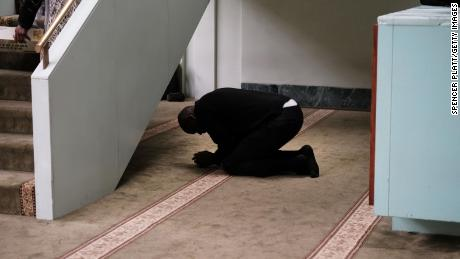 A man prays in a mosque in Manhattan after a terror attack at two mosques in New Zealand on March 15.