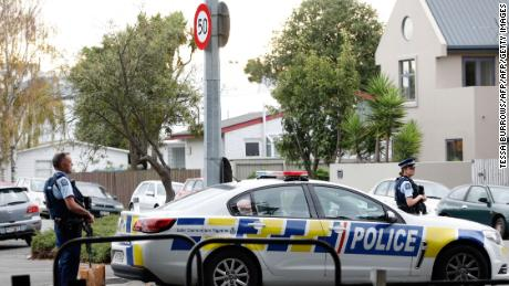Police are guarding the area in front of the Masjid al-Nur mosque after shooting at Christchurch on Friday.