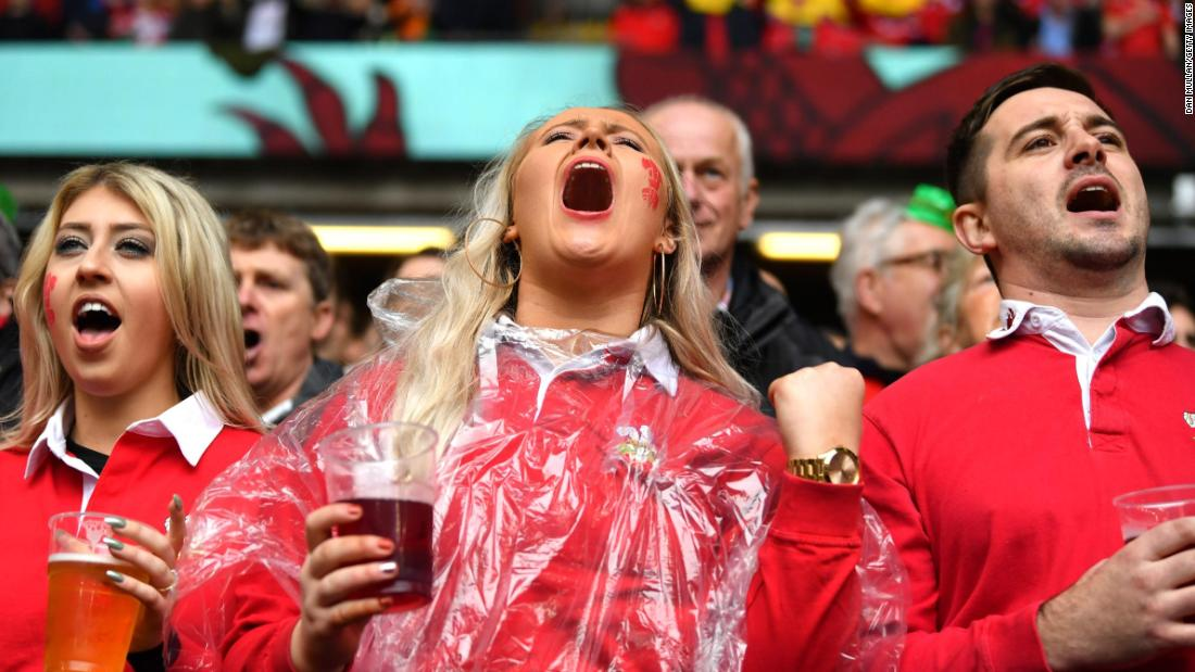 Welsh fans were in good voice in Cardiff despite the deluge.