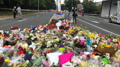 Tributes laid at the police line near the Al Noor mosque in Christchurch where 41 people died