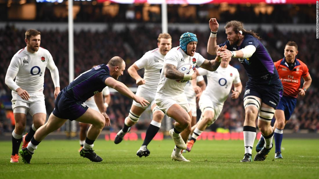 The title had been won before England took on Scotland but the men in white exploded out of the blocks. Jack Nowell threaded his way over for England's opener at Twickenham.