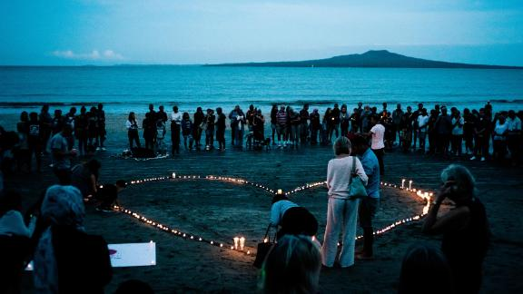 AUCKLAND, NEW ZEALAND - MARCH 16: Crowds gather on Takapuna beach for a vigil in memory of the victims of the Christchurch mosque terror attacks on March 16, 2019 in Auckland, New Zealand. 49 people are confirmed dead, with 36 injured still in hospital following shooting attacks on two mosques in Christchurch on Friday, 15 March. 41 of the victims were killed at Al Noor mosque on Deans Avenue and seven died at Linwood mosque. Another victim died later in Christchurch hospital. A 28-year-old Australian-born man, Brenton Tarrant, appeared in Christchurch District Court on Saturday charged with murder. The attack is the worst mass shooting in New Zealand's history. (Photo by Cam McLaren/Getty Images)
