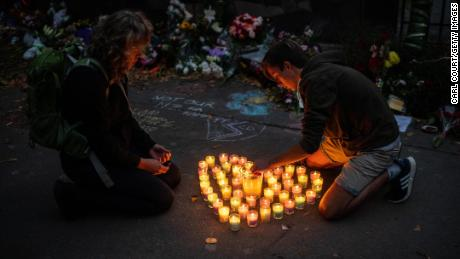 CHRISTCHURCH, NEW ZEALAND - MARCH 17: People light candles next to flowers and tributes laid by the wall of the Botanic Gardens on March 17, 2019 in Christchurch, New Zealand. 50 people are confirmed dead, with 36 injured still in hospital following shooting attacks on two mosques in Christchurch on Friday, 15 March. 41 of the victims were killed at Al Noor mosque on Deans Avenue and seven died at Linwood mosque. Another victim died later in Christchurch hospital. A 28-year-old Australian-born man, Brenton Tarrant, appeared in Christchurch District Court on Saturday charged with murder. The attack is the worst mass shooting in New Zealand's history. (Photo by Carl Court/Getty Images)