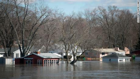 The Rock River crested its banks and flooded Shore Drive on Saturday, March 16 in Machesney Park, Illinois.