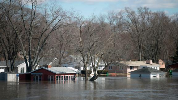 The Rock River crested its banks and flooded Shore Drive on Saturday, March 16 in Machesney Park, Illinois. Many rivers and creeks in the Midwest are at record levels after days of snow and rain. (Scott P. Yates/Rockford Register Star via AP)