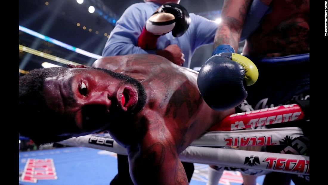Jean Pierre Augustin falls out of the ring after being hit by Chris Arreola during a Premier Boxing Champions Heavyweight Bout at AT&T Stadium in Arlington, Texas, on Saturday, March 16.