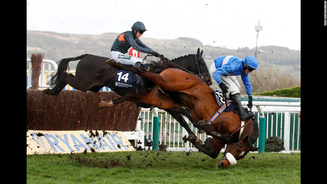 King's Odyssey, ridden by Adam Wedge, falls during the 4.10 Brown Advisory & Merriebelle Stable Plate Handicap Chase in Cheltenham, England, on Thursday, March 14.