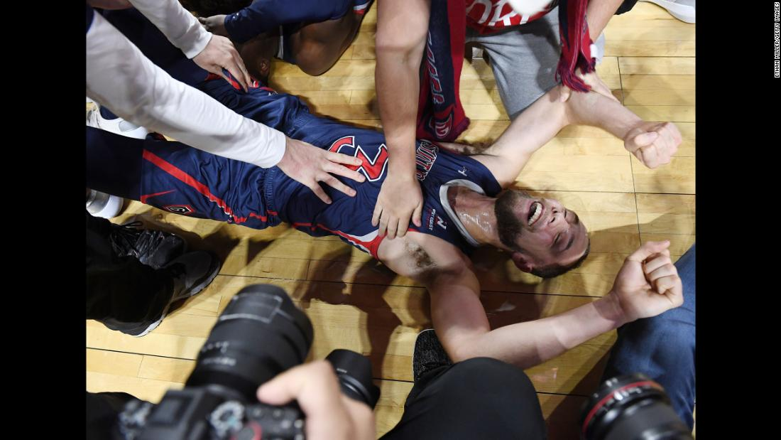 Jordan Ford of the Saint Mary's Gaels is mobbed by teammates and media on the court after the Gaels defeated the Gonzaga Bulldogs 60-47 to win the championship game of the West Coast Conference basketball tournament at the Orleans Arena in Las Vegas on Tuesday, March 12.