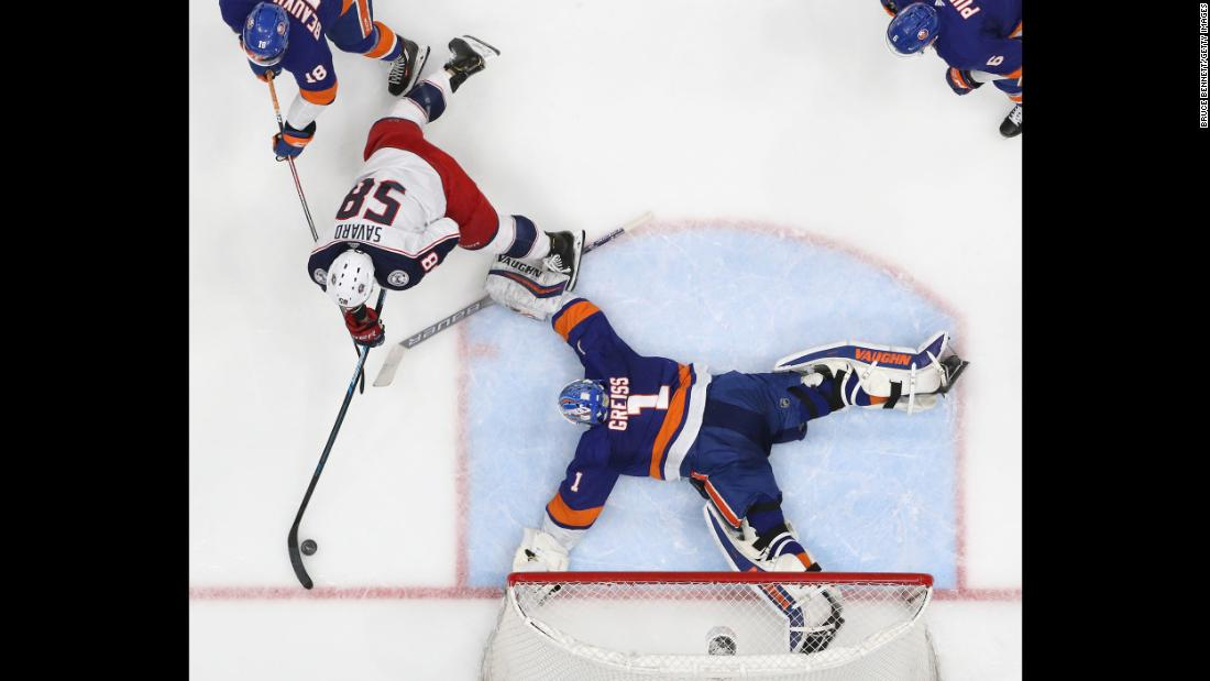 Thomas Greiss, right, of the New York Islanders makes a second-period save on David Savard of the Columbus Blue Jackets at the NYCB Live's Nassau Coliseum in Uniondale, New York, on Monday, March 11.