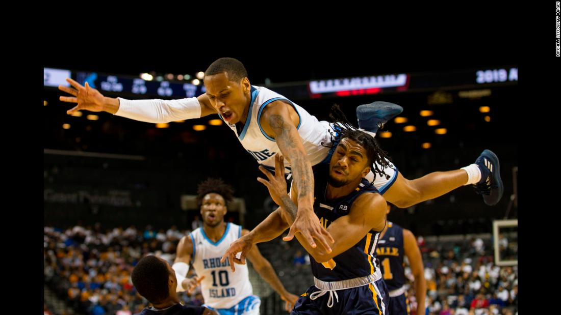 Fatts Russell, top, of the Rhode Island Rams goes up for a shot against Pookie Powell of the La Salle Explorers during the second round of the Atlantic 10 2019 tournament at the Barclays Center in Brooklyn, New York, on Thursday, March 14.