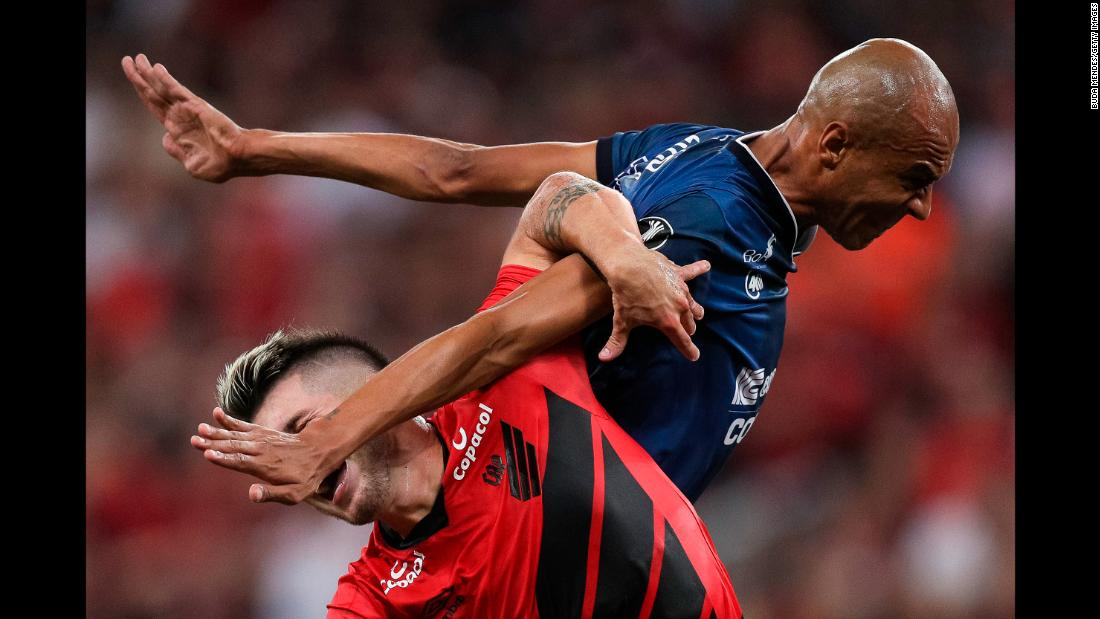 Tomas Andrade, left, of Athletico PR fights with Alex Silva of Jorge Wilstermann at a match during Copa CONMEBOL Libertadores 2019 at Arena da Baixada in Curitiba, Brazil, on Thursday, March 14.