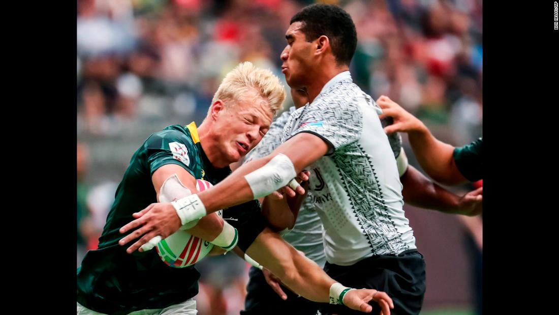South Africa's JC Pretorius, left, is tackled by Fiji's Meli Derenalagi during World Rugby Sevens Series game action in Vancouver, British Columbia, on Sunday, March 10.