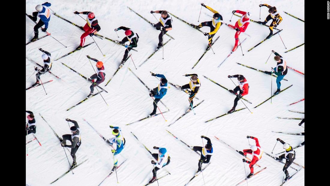 Athletes participate in the 51st annual Engadin skiing marathon in St. Moritz, Switzerland, on Sunday, March 10.