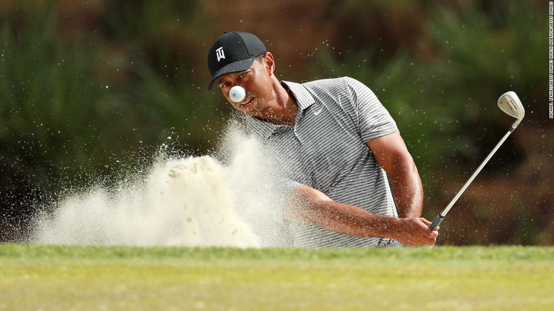 Tiger Woods of the United States plays a shot on the seventh hole during a practice round for The Players Championship on The Stadium Course at TPC Sawgrass in Ponte Vedra Beach, Florida, on Wednesday, March 13.