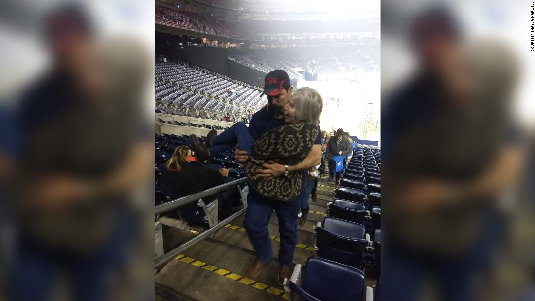 A picture of a firefighter carrying an elderly woman up some stairs is capturing hearts