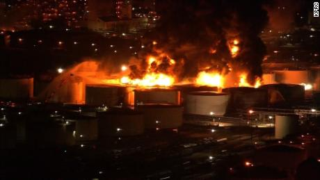 The fire ignited tanks containing gas, oil, naphtha, xylene and toluene, officials say.