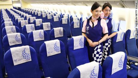 TOKYO, JAPAN - JANUARY 28:  (CHINA OUT, SOUTH KOREA OUT) Cabin crews pose in the 'Hello 2020 Jet' of the All Nippon Airways during the press preview at a hangar of Haneda Airport on January 28, 2018 in Tokyo, Japan.  (Photo by The Asahi Shimbun via Getty Images)