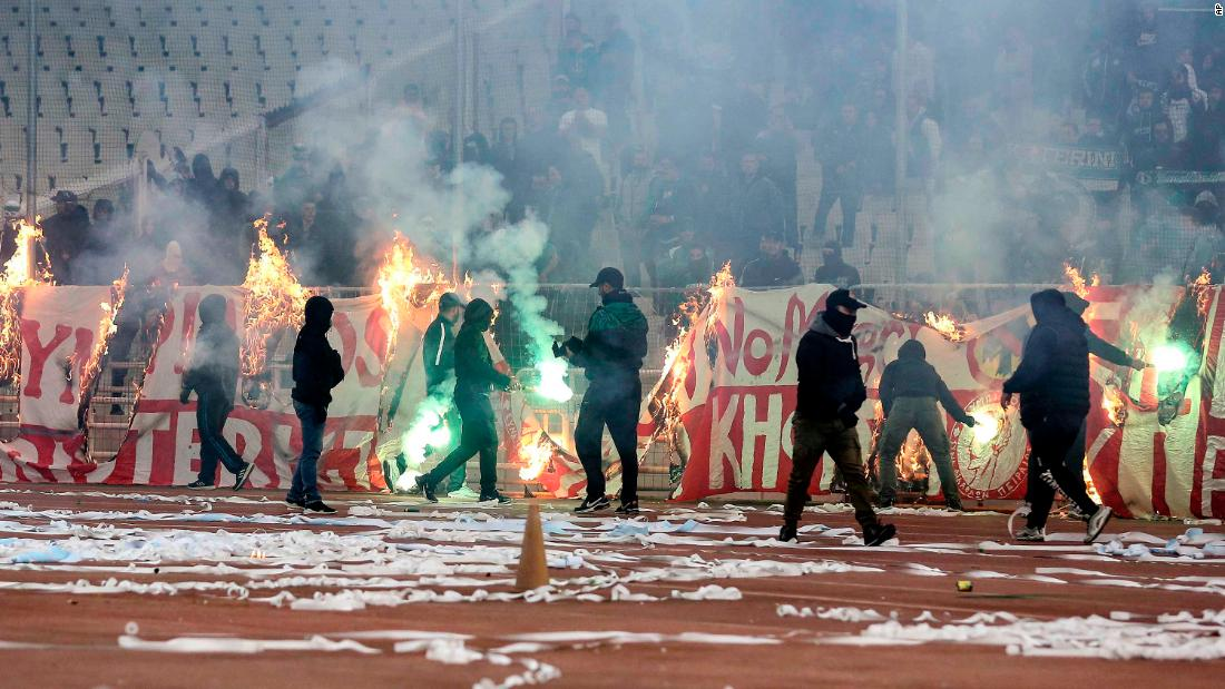 Fan violence, firebombs and teargas force Greek derby to be abandoned