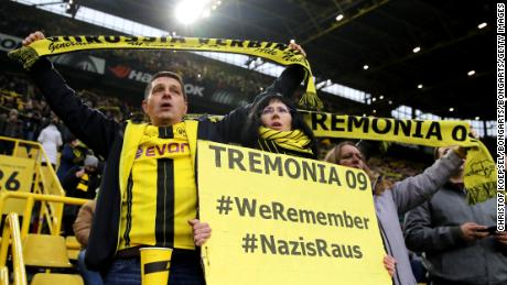 Borussia Dortmund fans display signs in tribute to victims of the Holocaust.