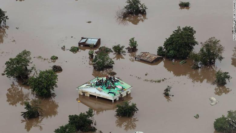 Flood victims take refuge on a roof in the aftermath of Cyclone Idai in Beira, Mozambique.