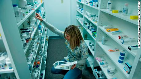 A staff member sorts through drugs drugs while filling a prescription at the Clay-Battelle Community Health Center's pharmacy March 21, 2017 in Blacksville, West Virginia. The Republican-controlled House of Representatives votes Thursday on a key plank of Trump's legislative agenda -- his plan to repeal and replace Obamacare, his predecessor's crowning domestic policy achievement. / AFP PHOTO / Brendan Smialowski        (Photo credit should read BRENDAN SMIALOWSKI/AFP/Getty Images)
