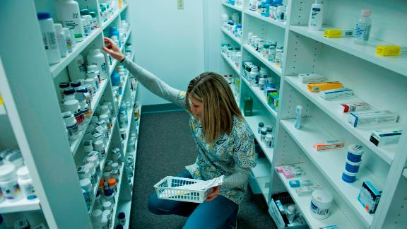 A staff member sorts through drugs drugs while filling a prescription at the Clay-Battelle Community Health Center