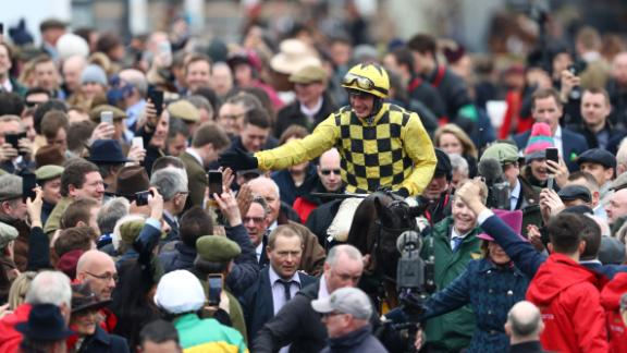A capacity crowd of nearly 70,000 descended on Prestbury Park in England's Cotswolds for the concluding Gold Cup day of the Festival.