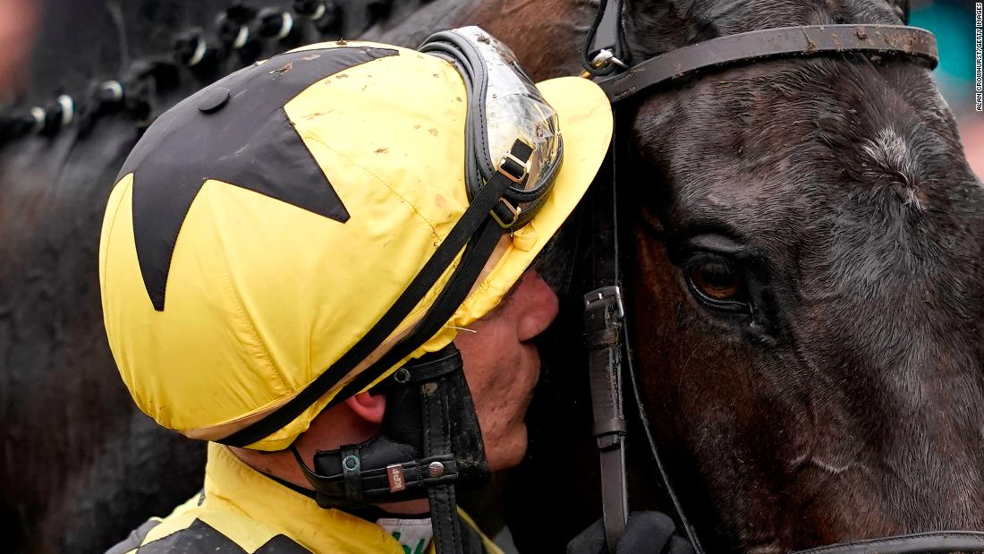 Jockey Paul Townend gives Al Boum Photo a kiss after they win the prestigious Cheltenham Gold Cup, the showpiece of jump racing's blue-riband Cheltenham Festival.