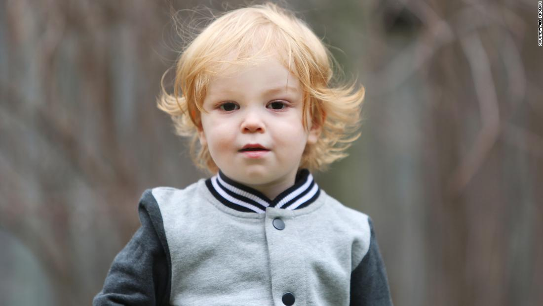 Jude McGee, who died of the flu at age two. His mother, Jill Promoli, has suffered abuse from anti-vaxers.