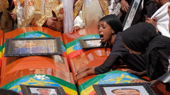 A woman lays on the coffin of her loved one during a memorial service on March 17 for the Ethiopian passengers and crew who died in the Ethiopian Airlines crash. All 157 people aboard the Boeing 737 Max 8 died when the flight went down six minutes after taking off from Bole Airport.