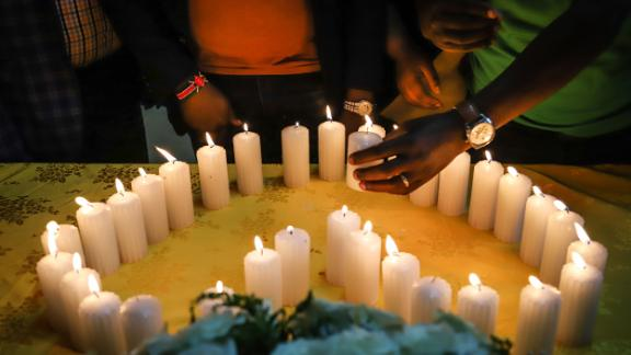 Relatives of Kenyan victims, who were among the 157 passengers and crew killed on the crashed Ethiopian Airlines flight, light candles during a memorial service at the Kenyan Embassy in Addis Ababa, on March 16.