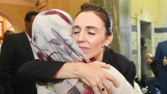 Prime Minister Jacinda Ardern embraces a woman who attended the House session at Parliament on March 19.