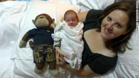 Stephanie Hathaway holds her first-born child Hadley