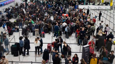 LONDON, ENGLAND - DECEMBER 20: Passengers wait for announcements at Gatwick South Terminal on December 20, 2018 in London, England. Authorities at Gatwick closed the runway after Drones were spotted over the airport on the night of December 19. The shutdown has sparked a succession of delays and diversions in the run up to the Christmas getaway, in what authorities have called a 'deliberate act' to disrupt the airport. (Photo by Dan Kitwood/Getty Images)