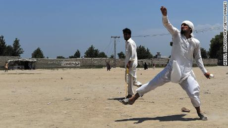 Afghan refugees play together at the Khurasan refugee camp in the suburbs of Peshawar, near the historic Khyber Pass, close to the border with Afghanistan.