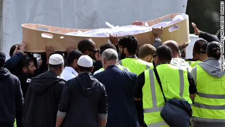 Mourners carry the coffin of a victim killed in the attack.